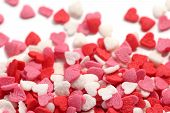 image of jimmy  - Colorful sugar sprinkles scattered on white background selective focus - JPG