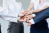 Business people making pile of hands. Partnership concept