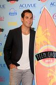 LOS ANGELES - AUG 11:  Skylar Astin in the 2013 Teen Choice Awards Press Room at the Gibson Ampithea