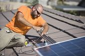 An Caucasian engineer fixing solar panel on rooftop
