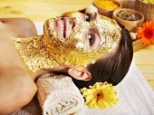 pic of cleopatra  - Woman getting  gold facial mask - JPG