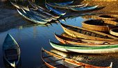 picture of coracle  - in early moring this place concentrate many small craft of fisherman who live with fishery small bamboo craft with multicolor under golden light at sunrise make beautiful scene - JPG