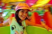 image of carousel horse  - Little girl having fun in a carousel - JPG