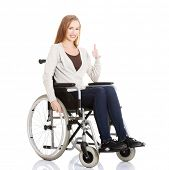 picture of wheelchair  - Beautiful caucasian woman sitting on a wheelchair - JPG