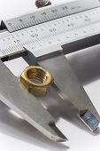 foto of vernier-caliper  - Vernier caliper being used for precision measurement - JPG
