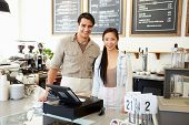 picture of takeaway  - Male And Female Staff In Coffee Shop - JPG