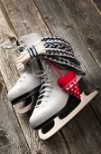 stock photo of skate board  - The white ice skates on old wooden boards - JPG