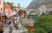 MOSTAR, BOSNIA AND HERZEGOVINA - AUGUST 9, 2012: Street market with the Old Bridge in background, UN