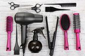 image of hair dye  - Hairdressing tools on white wooden table close - JPG