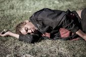 picture of scourge  - young homeless man sleeping - JPG