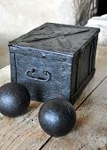 picture of cannon-ball  - look at the old black metal box and cannon balls - JPG