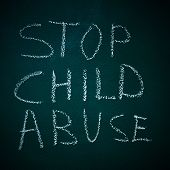 image of pedophilia  - sentence stop child abuse written in a chalkboard - JPG