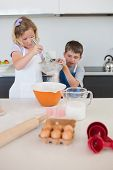 pic of flour sifter  - Children baking cookies together at kitchen counter - JPG