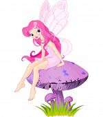picture of fairy-mushroom  - Pink fairy elf sitting on mushroom - JPG