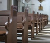 stock photo of pews  - Row of old pews in the Church interior - JPG