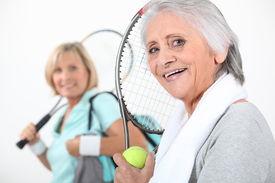 stock photo of peppy  - Women going to play tennis - JPG