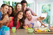 picture of selfie  - Group Of Friends Taking Selfie Whilst Celebrating Birthday - JPG
