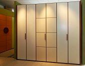 stock photo of wardrobe  - Big beige wardrobe closet in modern bedroom - JPG