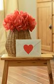 picture of pom poms  - Vase basket with red tissue paper flower - JPG