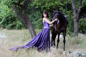 picture of beautiful horses  - The girl in a beautiful dress with a horse in the fairy forest - JPG
