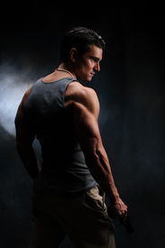 picture of hunk  - a muscle man stands and poses his body - JPG