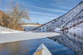 stock photo of collins  - winter canoe paddling on Horsetooth Reservoir near Fort Collins in northern Colorado - JPG