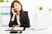 image of people talking phone  - happy business woman talking on the phone in office - JPG