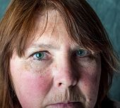 picture of grieving  - broken hearted woman  with pretty blue green eyes crying - JPG