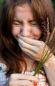 picture of hay fever  - Portrait of sneezing girl with hay - JPG