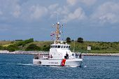 stock photo of coast guard  - US Coast Guard boat on security patrol in sea port - JPG