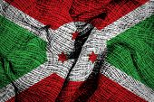 picture of burundi  - Burundi flag on old fabric surface background - JPG