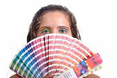pic of dtp  - Photo of a young woman holding a color guide - JPG