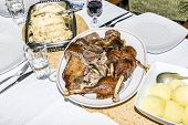 stock photo of roast duck  - Roast duck with apples and red cabbage - JPG