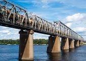 pic of railcar  - Petrivskiy railroad bridge in Kyiv across the Dnieper with freight train on it - JPG