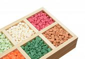 stock photo of nipple  - Assorted mix flavored nipple chips in box on white - JPG