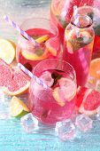 pic of pitcher  - Pink lemonade in glasses and pitcher on bright background - JPG