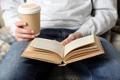 image of bookworm  - Young man reading book - JPG