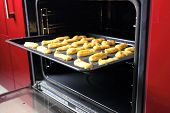 stock photo of eclairs  - Baking Eclair Cookie in the Oven - JPG