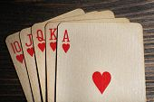 stock photo of ace spades  - Playing cards on wooden table - JPG