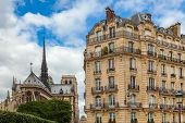 picture of notre dame  - View on typical parisian building as Notre Dame de Paris Cathedral on background - JPG