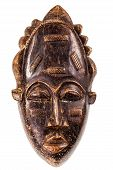 stock photo of cultural artifacts  - an ancient african wooden mask isolated over a white background - JPG