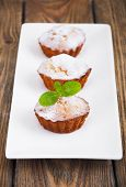 pic of bakeshop  - Homemade Muffins Ready for Breakfast on a plate on wooden background - JPG