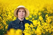 image of cultivation  - Female Farmer Standing and Posing in Oilseed Rapeseed Cultivated Agricultural Field Beauty Portrait - JPG