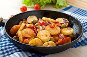 stock photo of lenten  - Baked potato with vegetables in a frying pan - JPG