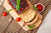 foto of meatloaf  - Homemade ground meatloaf with ketchup and basil - JPG