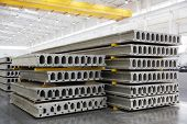 stock photo of slab  - Stack of precast reinforced concrete slabs in a house - JPG
