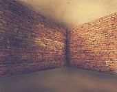 stock photo of dirty  - corner of old dirty interior with brick wall - JPG