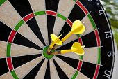 picture of bullseye  - dart board with three darts in bullseye - JPG