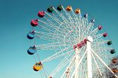 stock photo of color wheel  - Colorful Giant ferris wheel against blue sky background - JPG