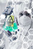 picture of hazardous  - Science and medical graphic against scientist in protective suit with hazardous chemical in flask - JPG